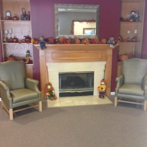 Lounge Area With Fireplace - Prairie Village Retirement Center